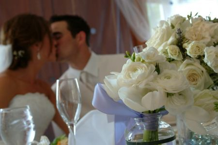 10-Bride-and-Groom-kiss-at-table
